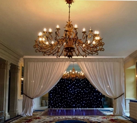 The stunning Lost Orangery at Euridge Manor. We created the curtain divide and star cloth with mirror-balls behind.