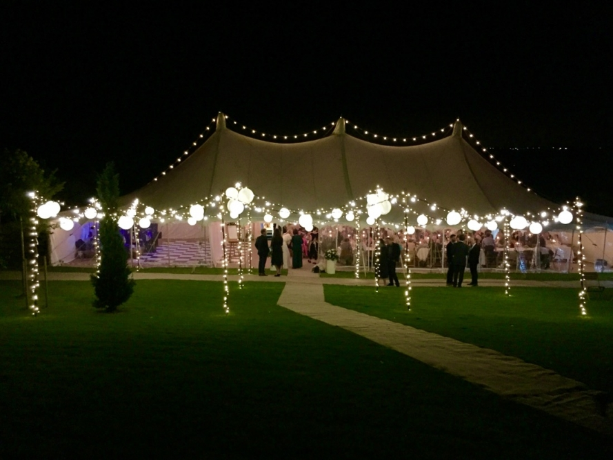 Image of a marquee with a STYLISH exterior canopy with fairy-lights and festoon.