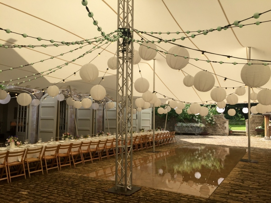 A stretch marquee with festoon lighting and white shades. New, intelligent festoon also shown.