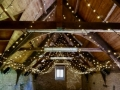 The beautiful Mells Barn in Somerset with additional fairy-light canopy supplied by STYLISH Entertainment