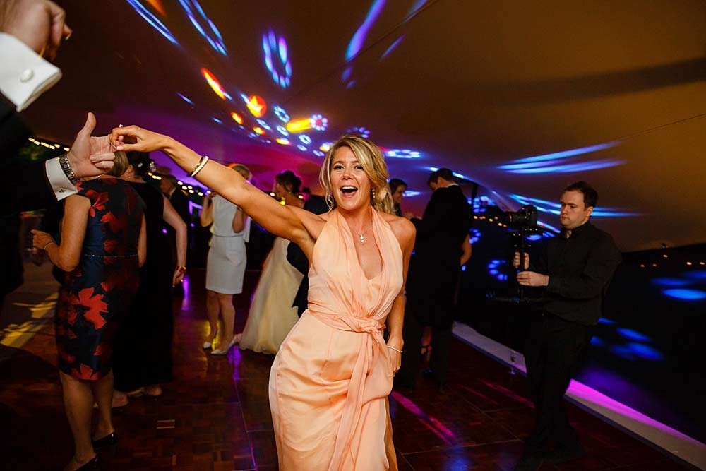 Wedding guest with arms in the air!