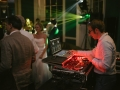Image of a DJ standing behind the decks at a Babington House Wedding.