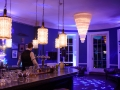 Violet LED up-lighting with DJ lighting for a wedding