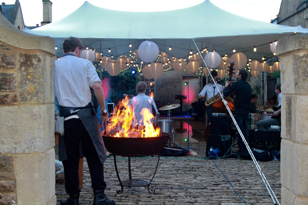 Image of a chef cooking on a fire-pit