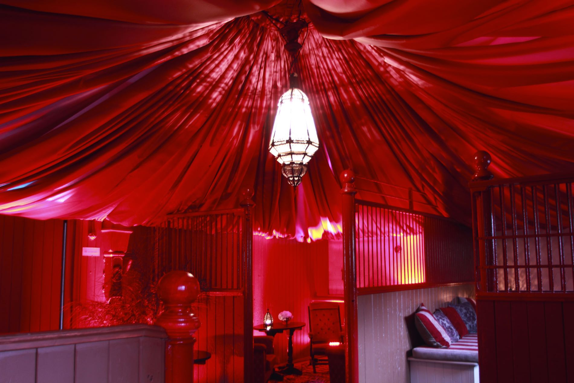 Image of a red canopied ceiling in a stable