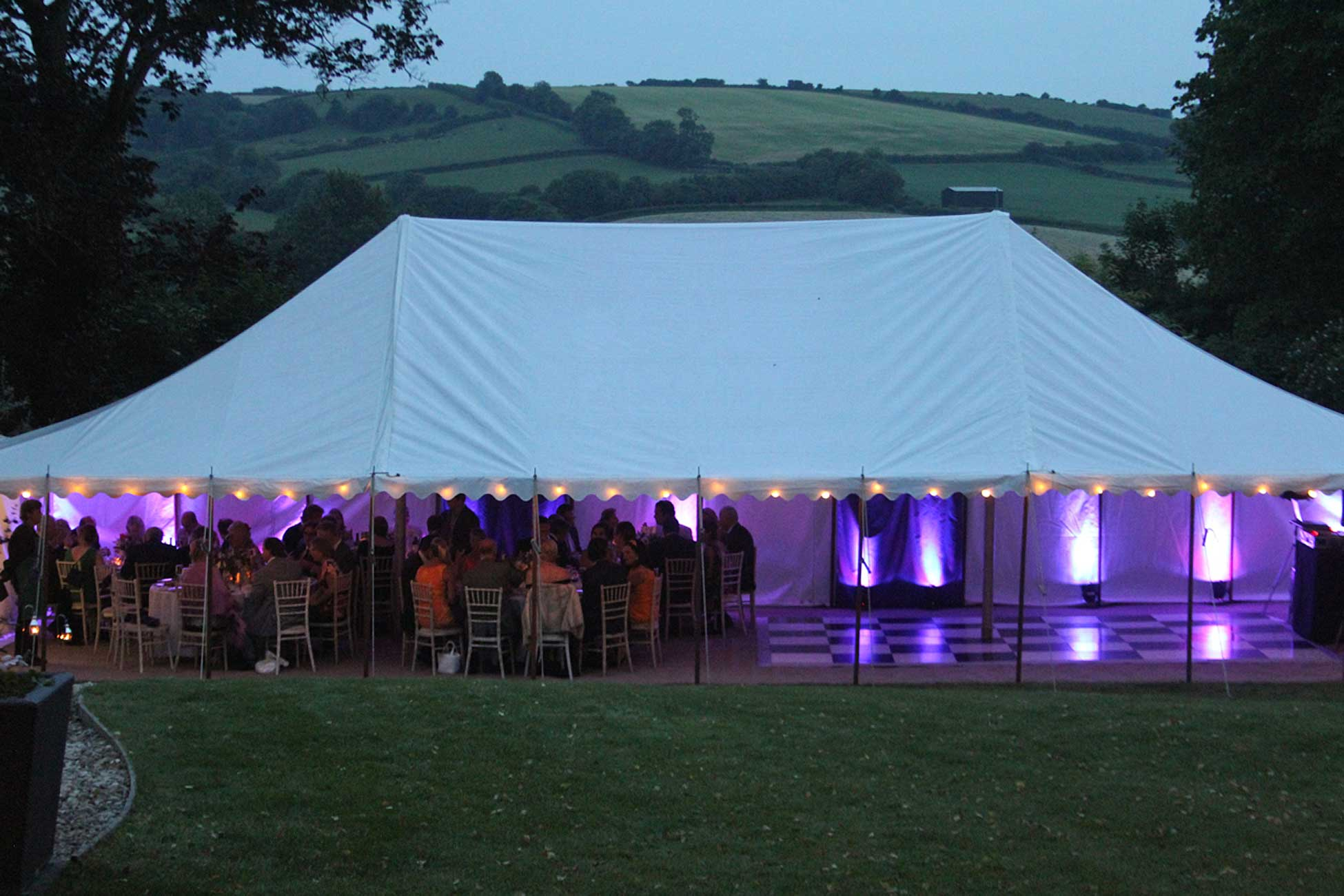 Image of a traditional marquee with additional mood lighting.