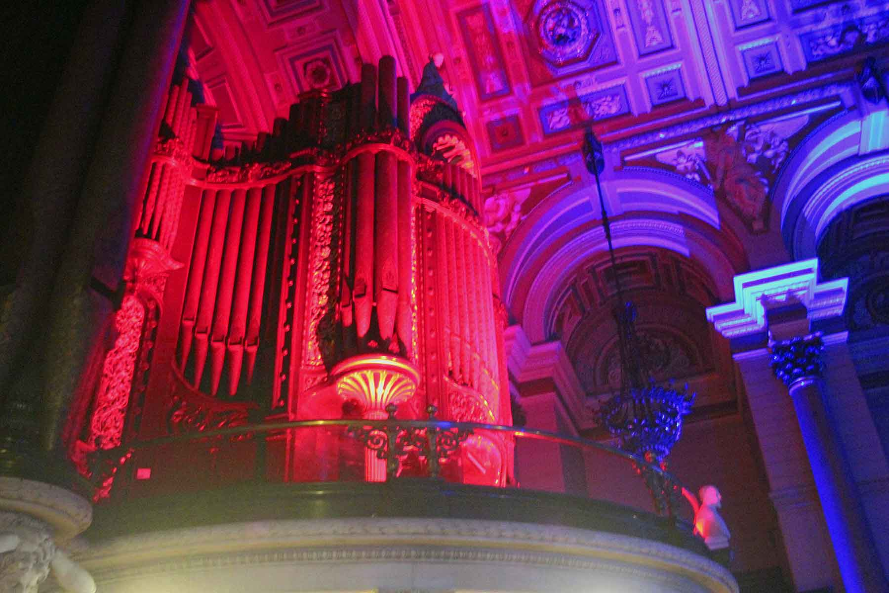 Image of St George's Hall in Liverpool with LED up-lighting lighting the massive organ.
