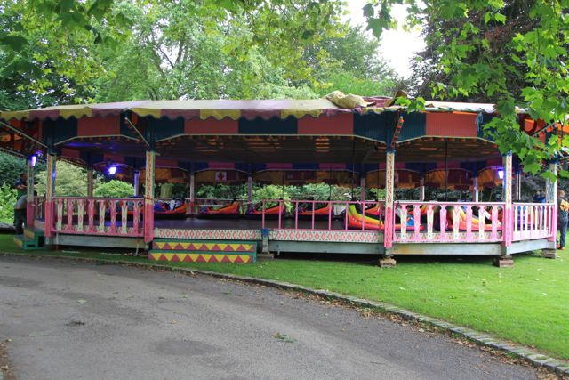 Image of a set of dodgems on a croquet lawn.
