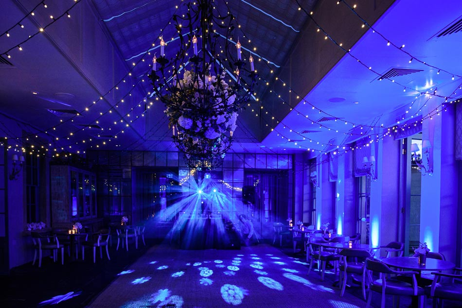Image of a fairy-light canopy with LED up-lighting and DJ lighting.