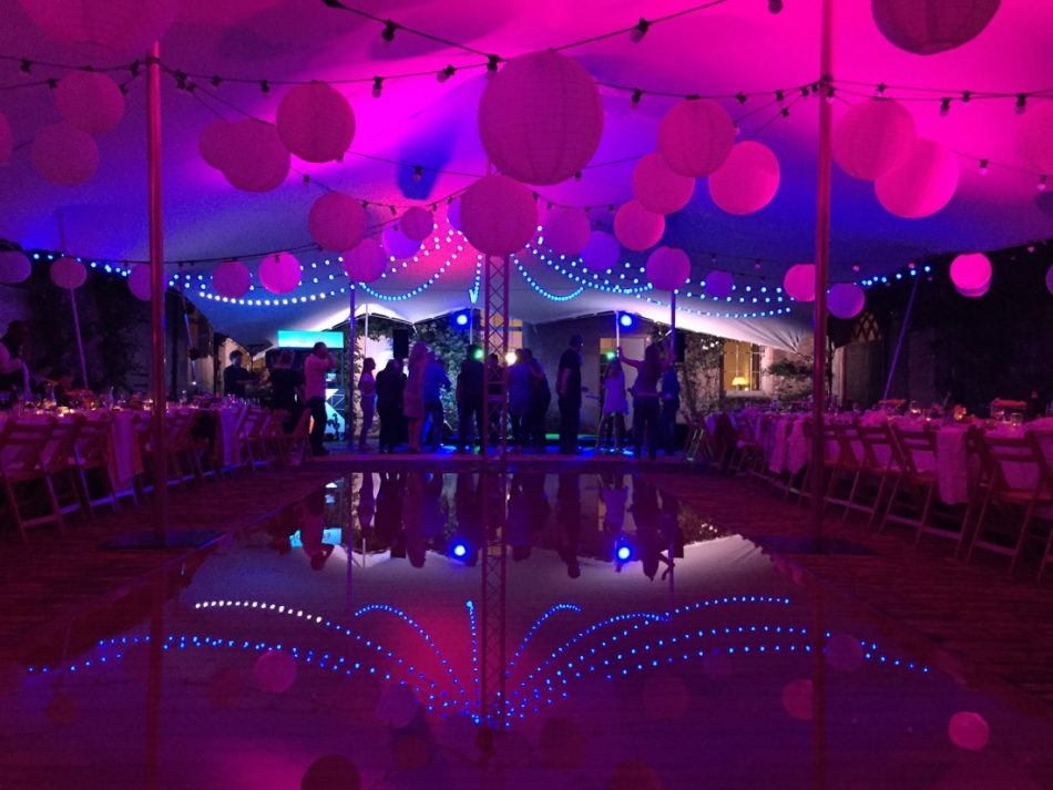 Pink stretch marquee with water feature.