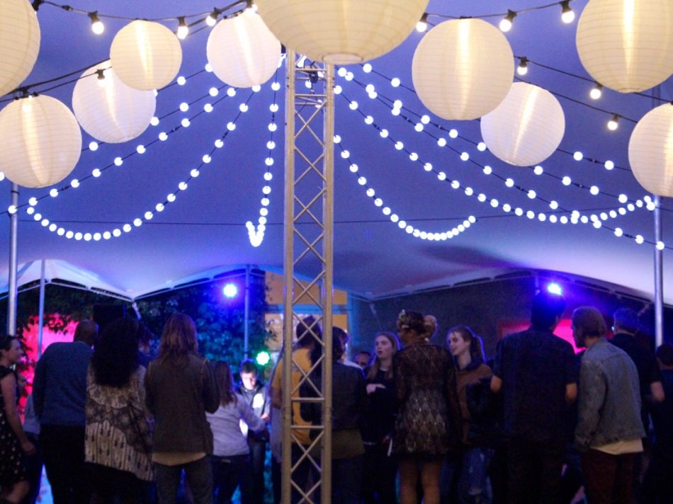 Image of a stretch marquee with white and coloured lighting.