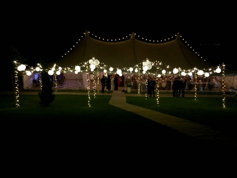Image of a marquee with a free standing canopy in the centre.