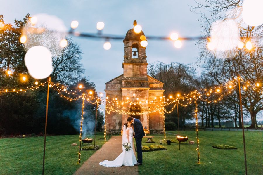 A Church with Bespoke wedding lighting canopy in fairy-lights.