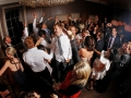 Image of a full dance-floor with everyone enjoying themselves.