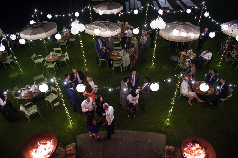 Image of a law with a lighting canopy installed for a wedding.
