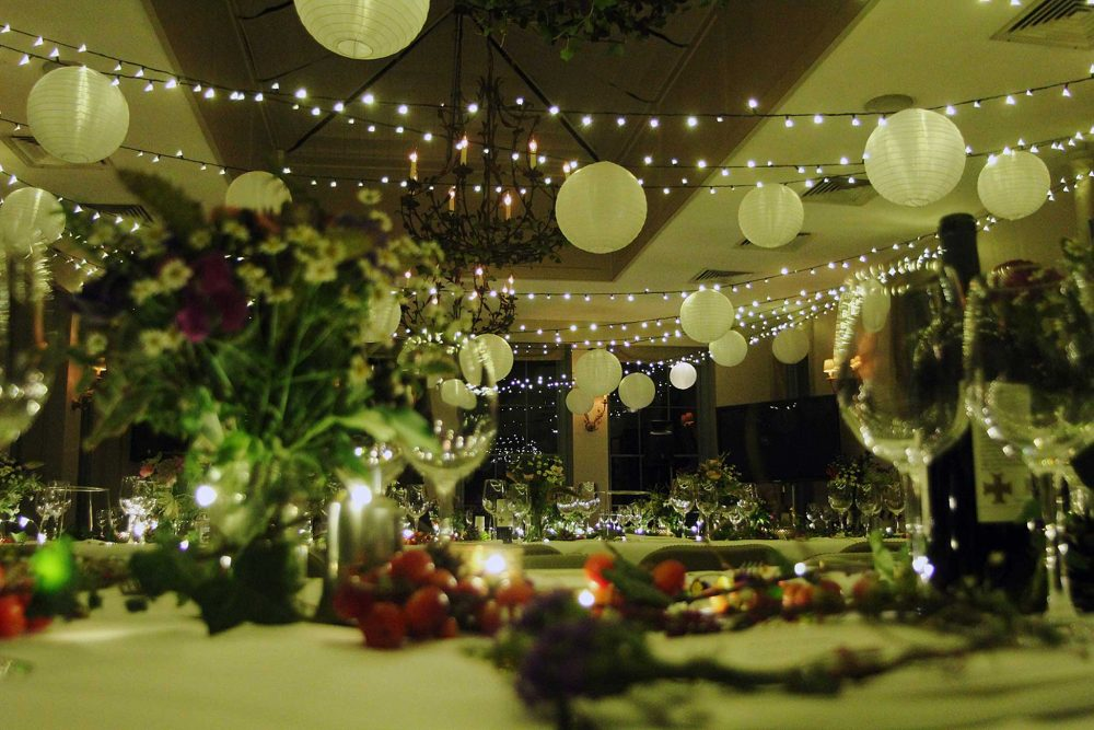 Fairy light canopy installed for a party at Babington House in Somerset.