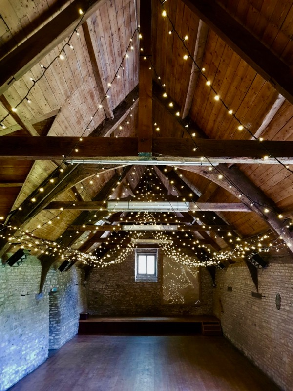 Mells Barn with fairy-lights installed in the ceiling.