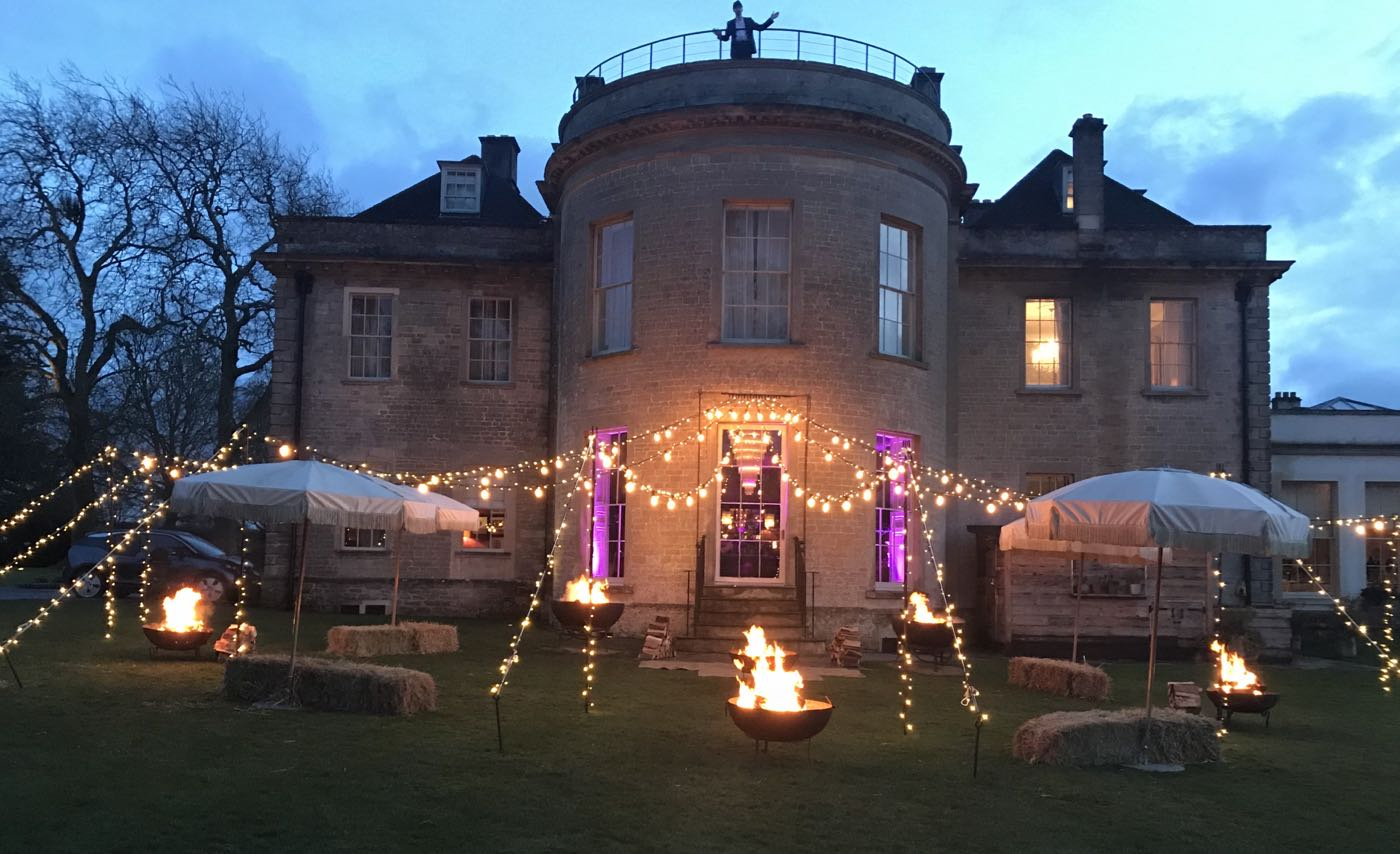 Image of Babington House Bar Terrace with Fairy-light canopy.